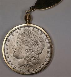 1879 Morgan   $1 Circulated  on a  Colored Metal Keychain